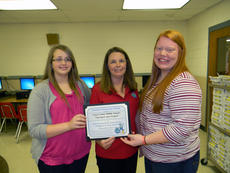 "<div class=""source"">SUBMITTED</div><div class=""image-desc"">Kayla Goad and Brenna Hayes accepted the school's PRIDE Environmental Education Project of the Month Award from PRIDE's Jennifer Johnson (center).</div><div class=""buy-pic""><a href=""/photo_select/20078"">Buy this photo</a></div>"