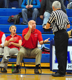 """<div class=""""source"""">Chris Zollner</div><div class=""""image-desc"""">Lady Rebel Coach Randy Salyers expresses displeasure to the referee shortly before getting his second technical foul. Assistant Coach Stacy Terry, left, took over after Salyers' ejection.</div><div class=""""buy-pic""""></div>"""