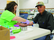 """<div class=""""source""""></div><div class=""""image-desc"""">Rufus Shoopman gets his blood drawn from Casey County Hospital Lab Tech Rachael Luttrell at the hospital's annual Health Fair last year. This year's event is coming up Oct. 14.</div><div class=""""buy-pic""""><a href=""""/photo_select/23496"""">Buy this photo</a></div>"""