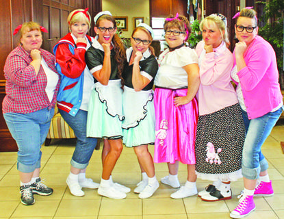 Casey County Bank employees donned '50s garb for the occasion. Left, Teresa Luttrell, Tina Coffman, Rhonda Blevins, Jill Passmore, Lisa Russell, Sarah Ruth Beard, and Abby Pittman.