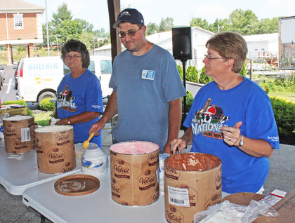 Brenda Goode, left, and son, Greg Goode, serve ice cream to visitors alongside DanaMorgan. Greg Goode and other Casey County Dairy farmers began this event as a way to celebrate Dairy Month, which he said brings awareness to the dairy industry.