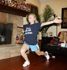 "<div class=""source"">Donna Carman</div><div class=""image-desc"">Jenna Rousey practices her fitness routine in the living room at her home recently. Rousey, who won the title of Casey's 2011 Junior Miss, will try to bring home the state title this weekend in Lexington.</div><div class=""buy-pic""><a href=""/photo_select/10954"">Buy this photo</a></div>"