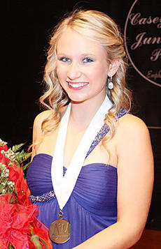 "<div class=""source"">Donna Carman</div><div class=""image-desc"">Jenna Rousey won the title of Casey's 2011 Junior Miss in August.</div><div class=""buy-pic""><a href=""/photo_select/10955"">Buy this photo</a></div>"