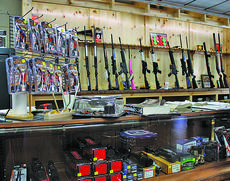 """<div class=""""source"""">ABIGAIL WHITEHOUSE</div><div class=""""image-desc"""">The shelves and cases at Green River Outdoors are stocked with everything from guns and ammo to knives, apparel and more.</div><div class=""""buy-pic""""></div>"""